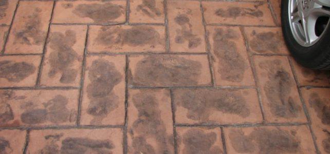 Detalle concreto estampado naranja gris